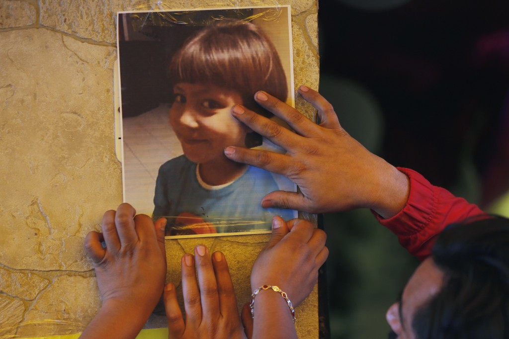 Relatives post a photo of Fatima, a 7-year-old girl who was abducted from the entrance of the Enrique C. Rebsamen primary school and later murdered, a...