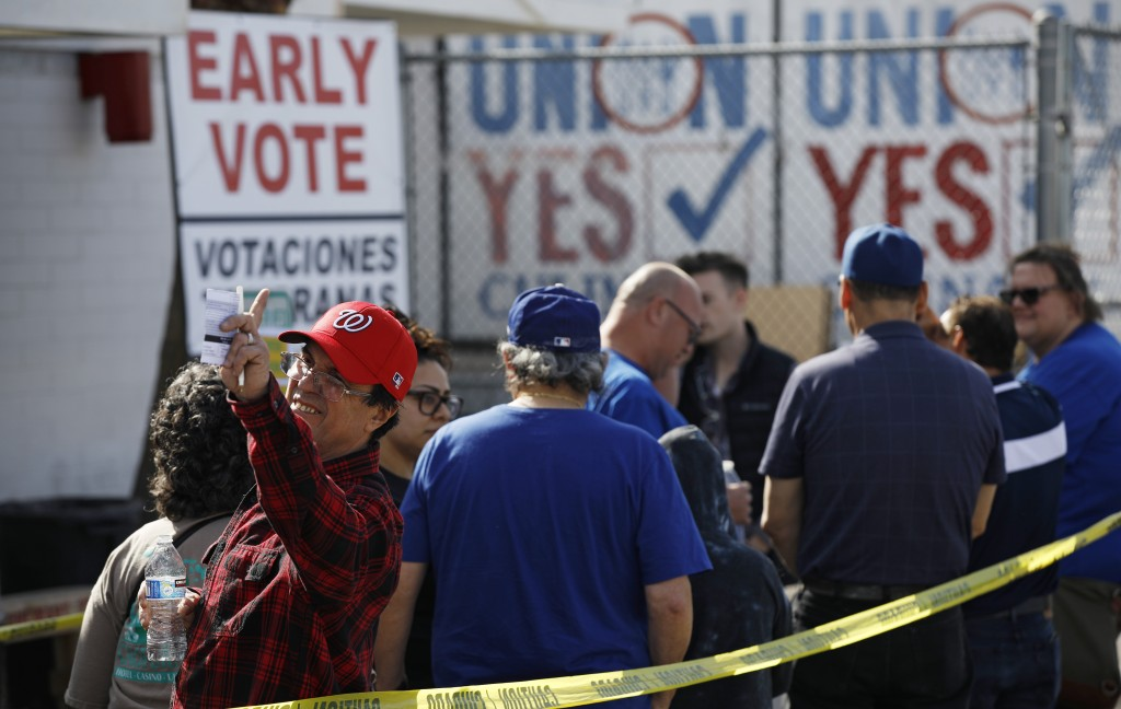 People wait in line to vote early at the Culinary Workers union Monday, Feb. 17, 2020, in Las Vegas. Nevada's first-in-the West presidential caucus pu...
