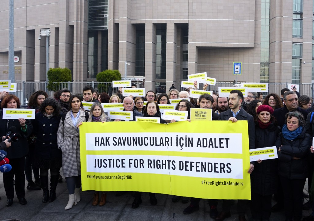 Turkish and international human rights activists face the media before the trial of the Amnesty International's former Turkey chairman and 10 other ac...