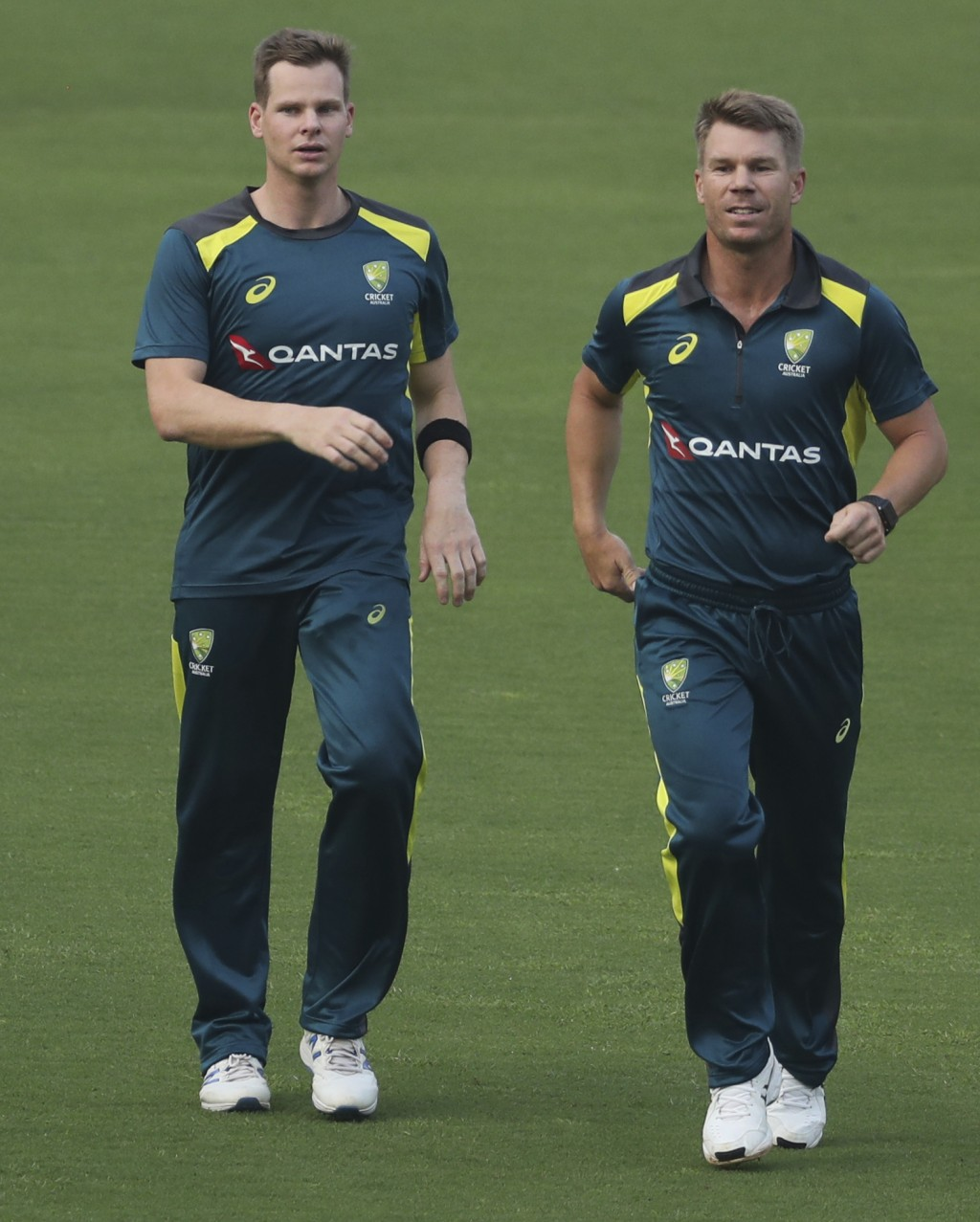 FILE - In this Saturday, Jan. 11, 2020 file photo, Australia's Steve Smith, left, and David Warner attend a training session in Mumbai, India. David W...