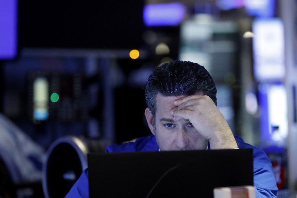 Trader Glenn Kessler works on the floor of the New York Stock Exchange, Tuesday, Feb. 18, 2020. U.S. stocks slipped in early trading Tuesday after tec...
