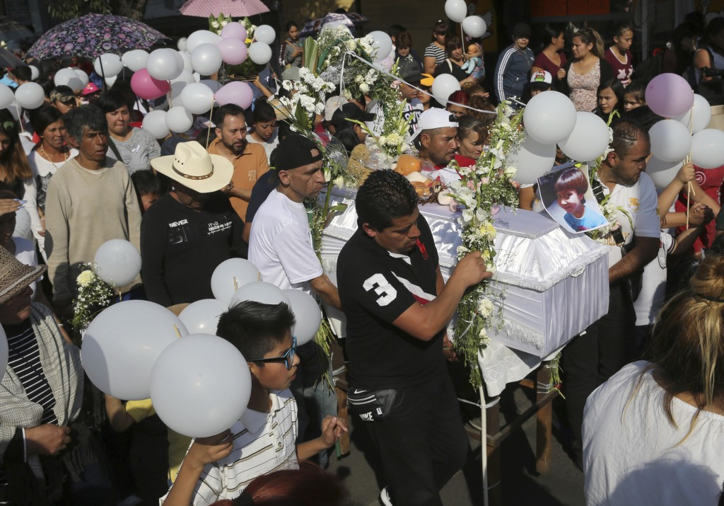 The casket of 7-year-old murder victim Fatima is taken from her home to a church for a funeral Mass in Mexico City, Tuesday, Feb. 18, 2020. The girl w...