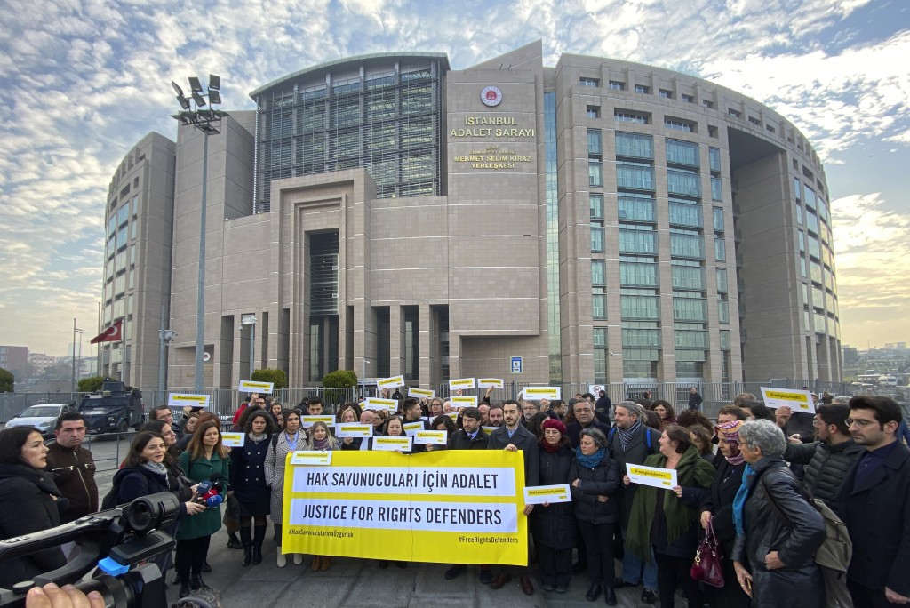 Turkish and international human rights activists speak to the media before the trial of the Amnesty International's former Turkey chairman and 10 othe...
