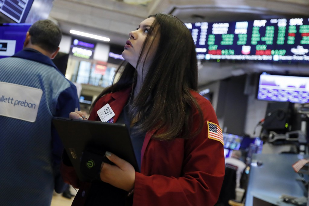 FILE - In this Feb. 5, 2020, file photo trader Ashley Lara works on the floor of the New York Stock Exchange. The U.S. stock market opens at 9:30 a.m....