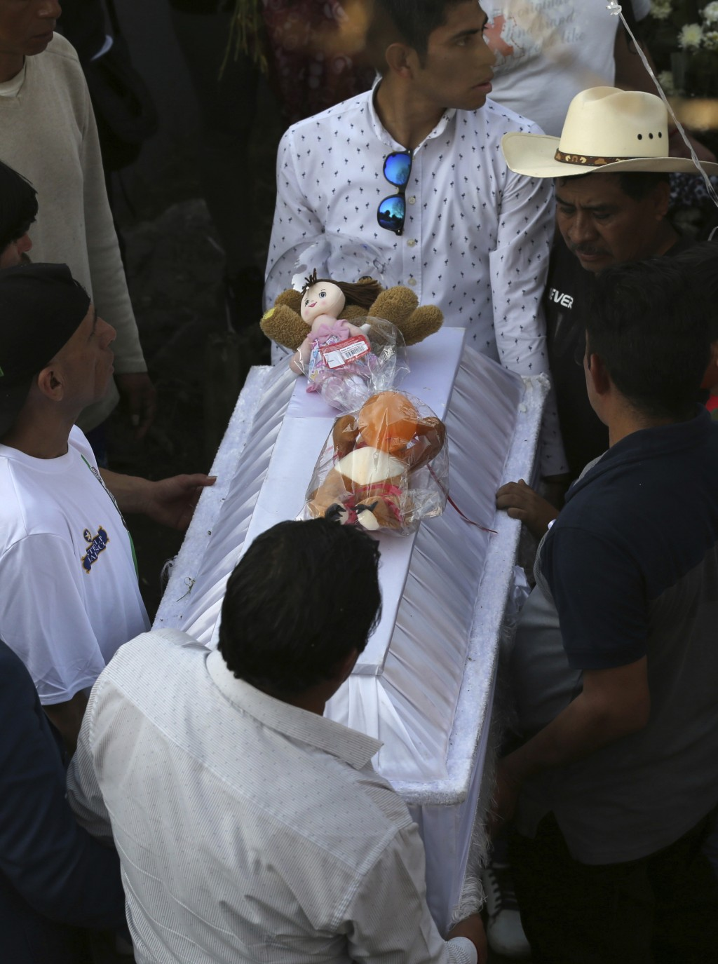 Family members bury 7-year-old murder victim Fatima in Mexico City, Tuesday, Feb. 18, 2020. Fatima's body was found wrapped in a bag and abandoned in ...