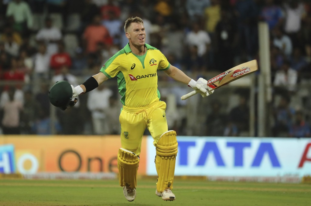 FILE - In this Tuesday, Jan. 14, 2020 file photo, Australia's David Warner celebrates after scoring a hundred during the first one-day international c...