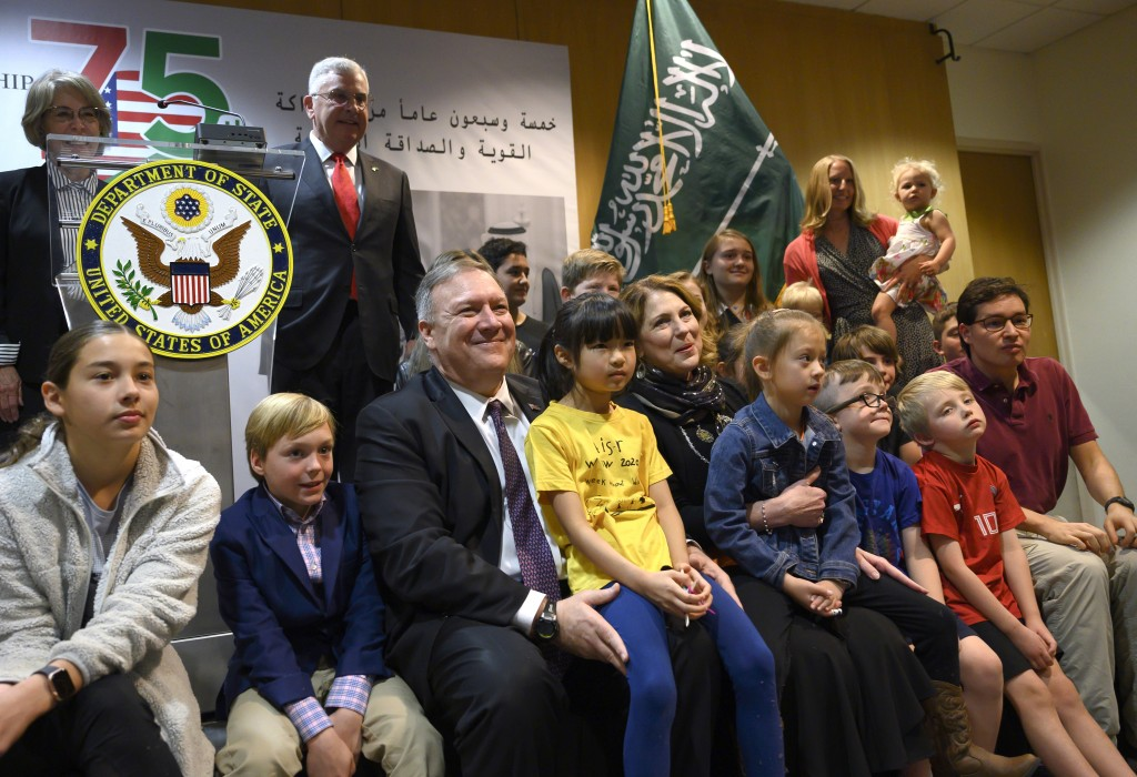 U.S. Secretary of State Mike Pompeo, center left, and his wife Susan, center right, meet with family members at the U.S. embassy in Riyadh Thursday, F...
