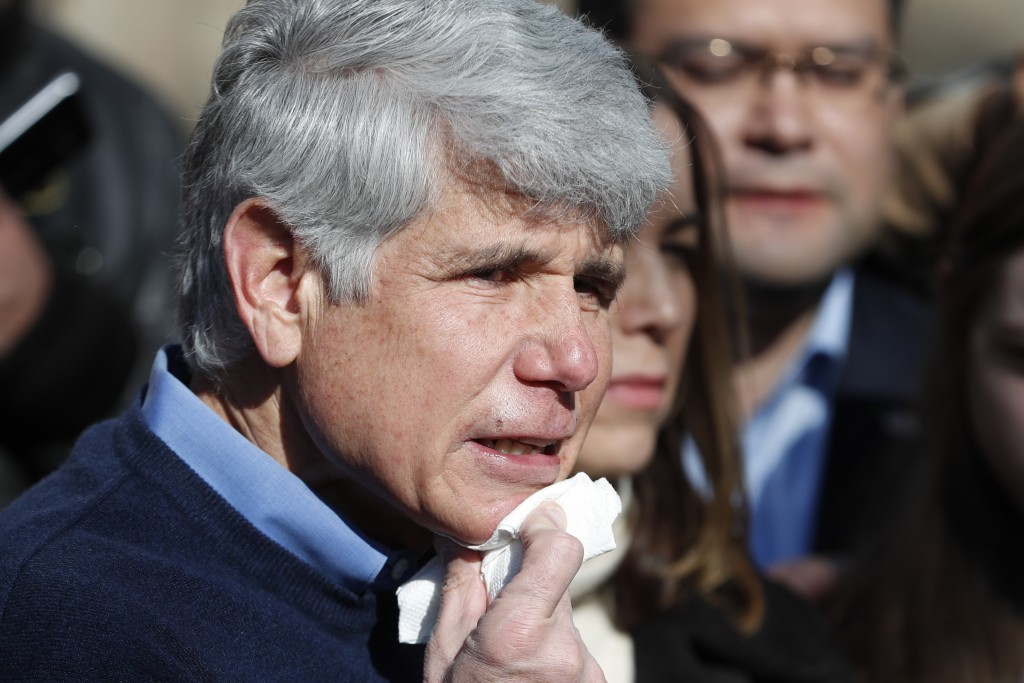 Former Illinois Gov. Rod Blagojevich dabs blood from his chin during a news conference outside his home Wednesday, Feb. 19, 2020, in Chicago. On Tuesd...