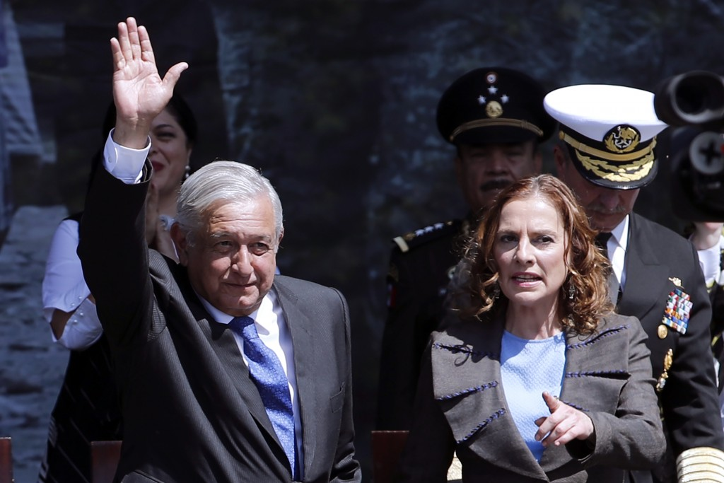 Mexico's President Andres Manuel Lopez Obrador waves during an event marking Army Day at the Zocalo, accompanied by first lady Beatriz Gutierrez Mulle...