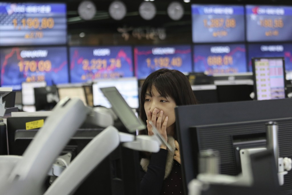 A currency trader watches monitors at the foreign exchange dealing room of the KEB Hana Bank headquarters in Seoul, South Korea, Thursday, Feb. 20, 20...