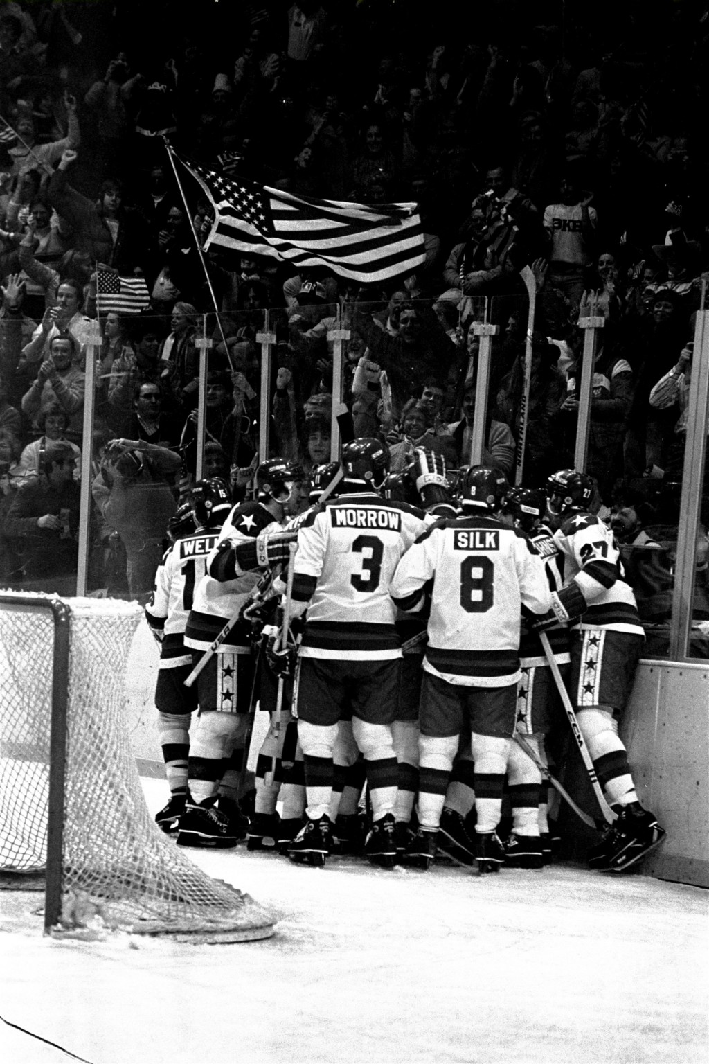 FILE - In this Feb. 22, 1980, file photo, U.S. ice hockey players celebrate after a first period goal by Buzz Schneider against the Soviet Union at th...