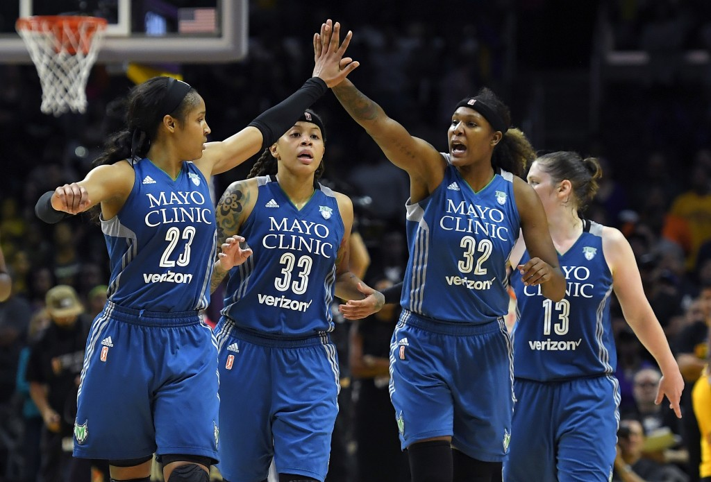 FILE - In this Oct. 16, 2016, file photo, members of the Minnesota Lynx, from left, Maya Moore, Seimone Augustus, Rebekkah Brunson and Lindsay Whalen ...