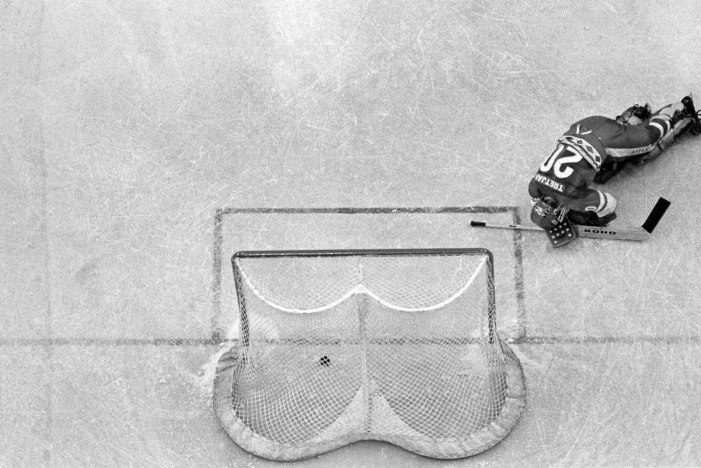 In this Feb. 22, 1980, file photo, Soviet Union hockey goalie Vladislav Tretiak falls to the ice as a goal is scored by U.S. player Mark Johnson (not ...