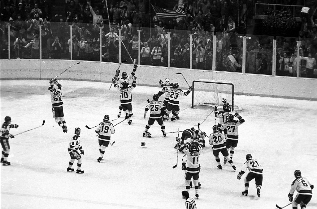 FILE - In this Feb. 22, 1980, file photo, the U.S. ice hockey team rushes toward goalie Jim Craig after their 4-3 upset win over the Soviet Union in a...