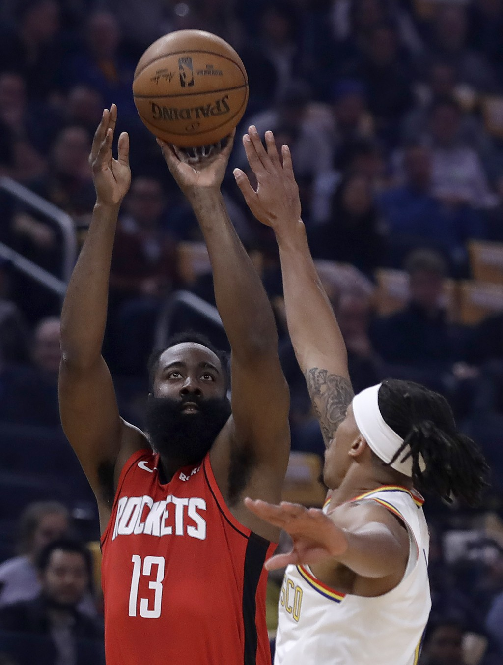 Houston Rockets' James Harden (13) shoots against Golden State Warriors' Damion Lee in the first half of an NBA basketball game Thursday, Feb. 20, 202...