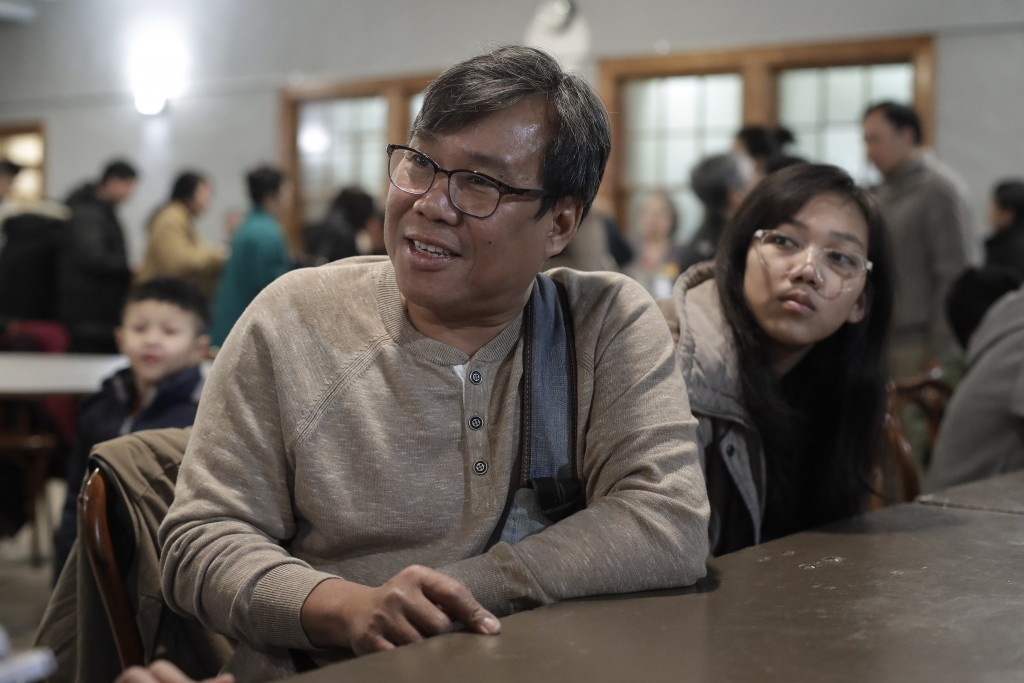 In this Sunday, Feb. 16, 2020, photo S'Tha Sein, left, and his daughter Lunn KyiPhyu Tha, 15, right, both immigrants from Myanmar, also known as Burma...