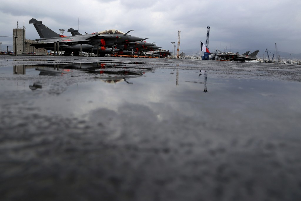 Rafale warplanes on the deck of the aircraft carrier Charles de Gaulle, docked at Cyprus' main port of Limassol, Friday, Feb. 21, 2020. Rear Admiral M...