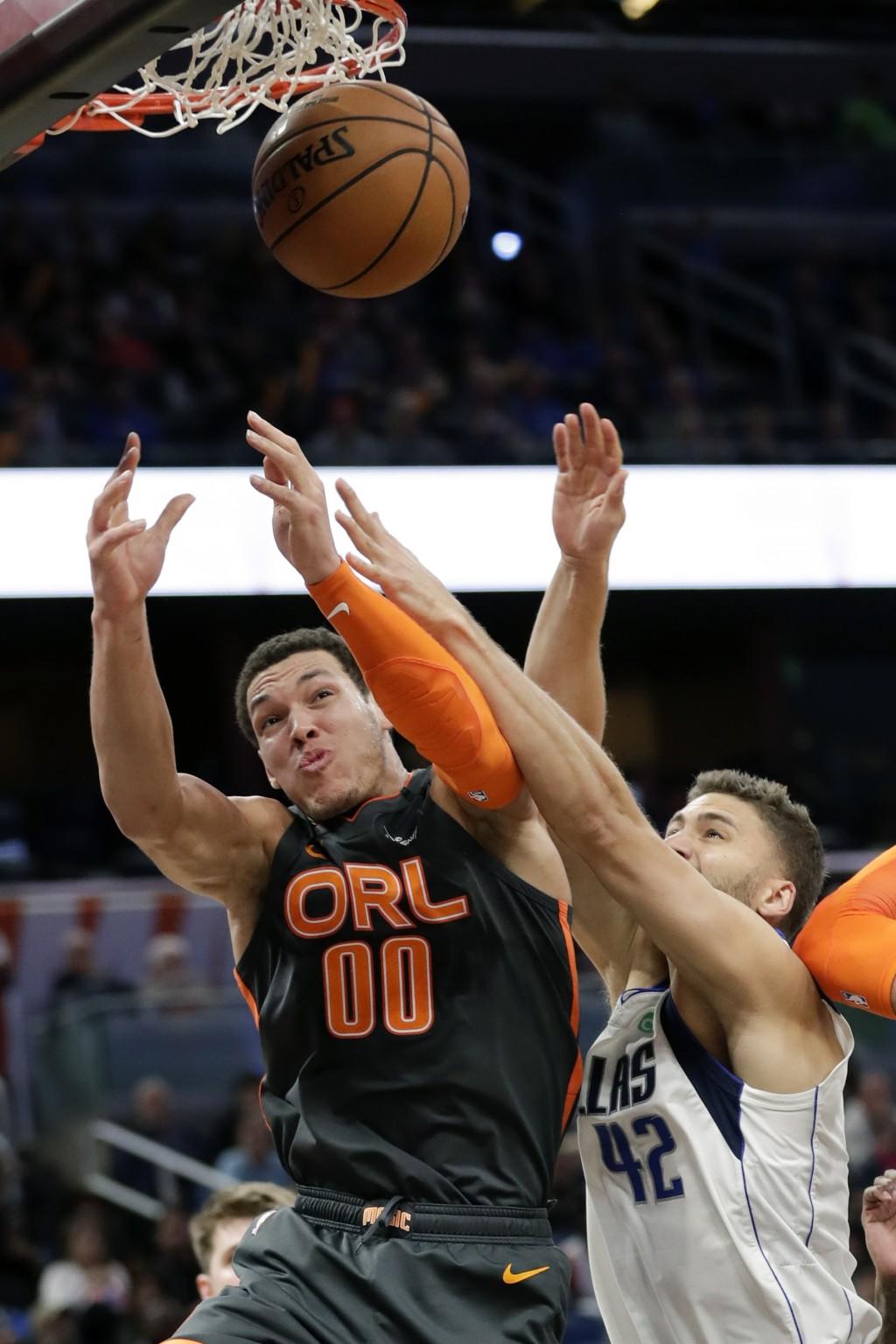 Orlando Magic forward Aaron Gordon (00) battles Dallas Mavericks forward Maxi Kleber (42) for a rebound during the second half of an NBA basketball ga...