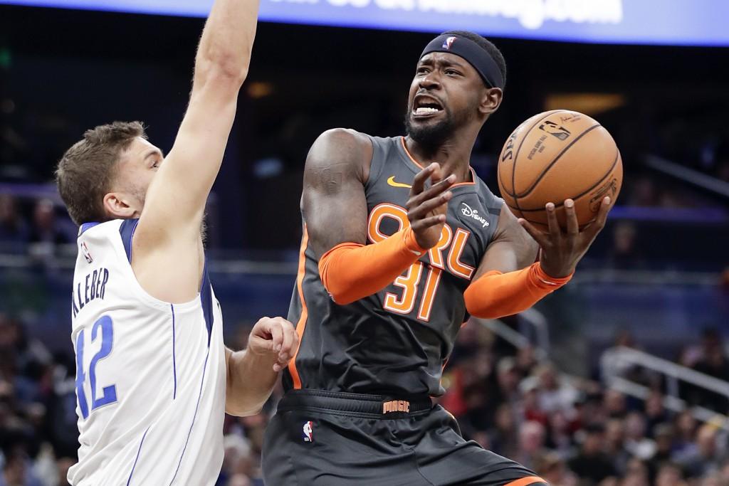 Orlando Magic guard Terrence Ross (31) attempts to shoot against Dallas Mavericks forward Maxi Kleber during the second half of an NBA basketball game...