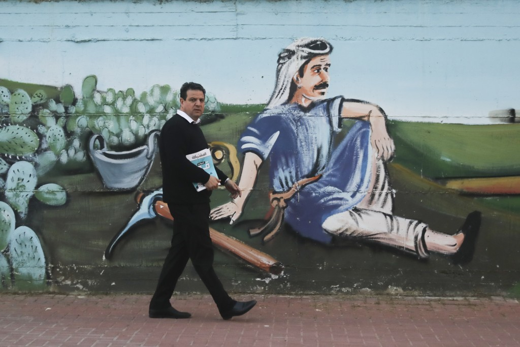 Ayman Odeh, Israeli Arab parliament member and leader of the Joint List alliance, walks during an election campaign event in then town of Yabeh, West ...
