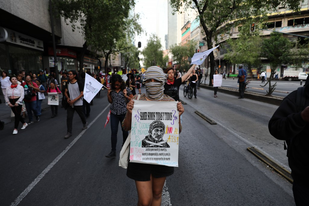 Farm workers and activists march along Reforma Avenue in Mexico City, Friday, Feb. 21, 2020. Demonstrators are protesting Mexican President Andre Manu...