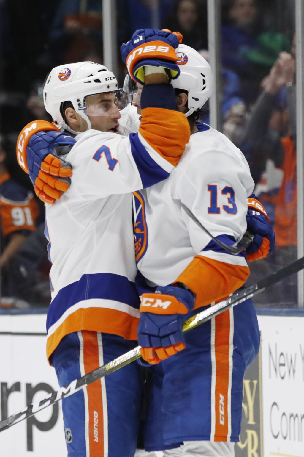 New York Islanders right wing Jordan Eberle (7) celebrates with center Mathew Barzal (13) after Eberle scored his second goal of the night against the...