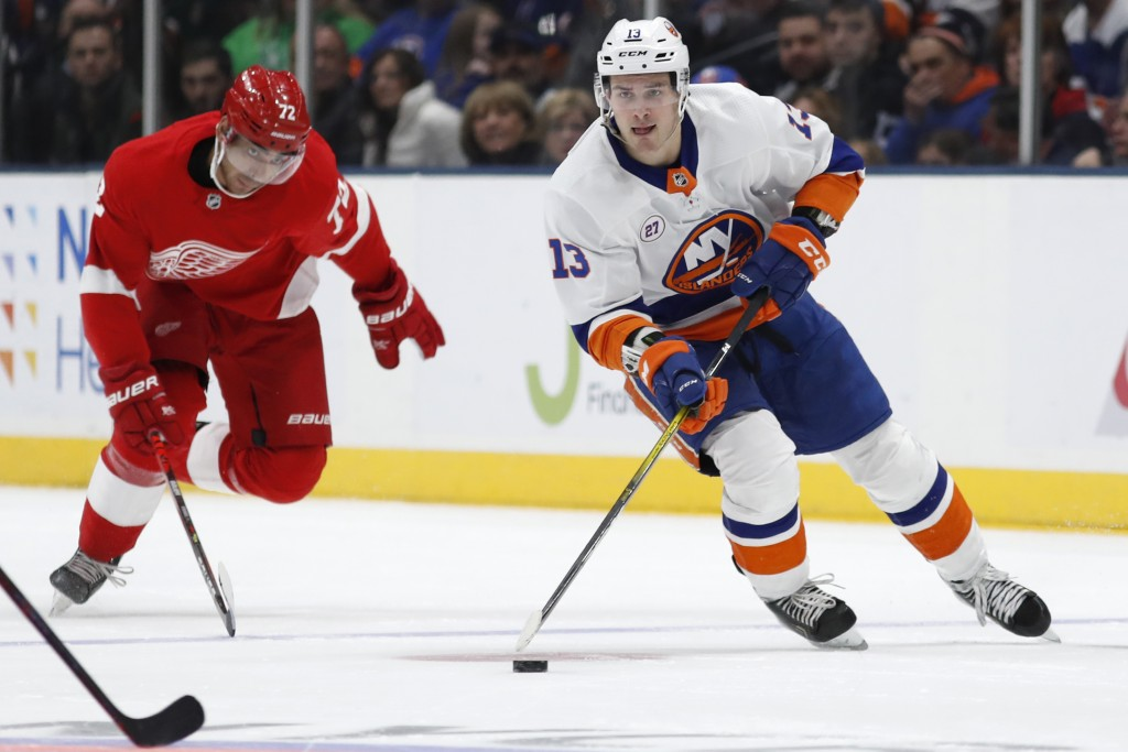 New York Islanders center Mathew Barzal (13) skates with the puck as Detroit Red Wings left wing Andreas Athanasiou (72) pursues during the second per...
