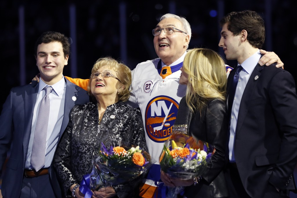 John Tonelli, center, who played for the New York Islanders during four Stanley Cup-championship seasons, stands with his mother, Joy; wife, Lauren; a...