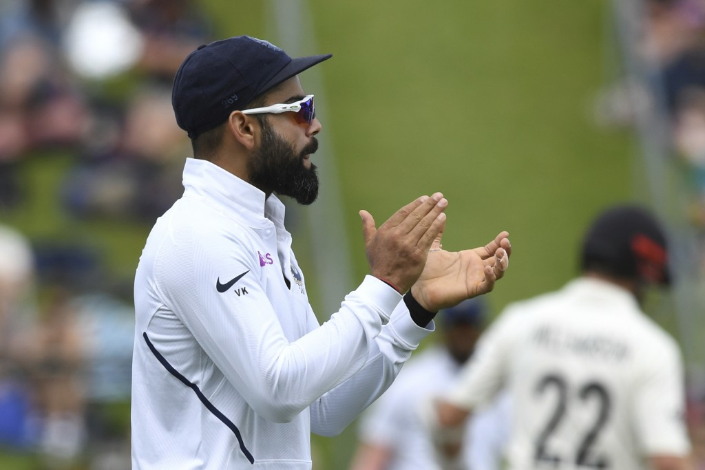 India's Virat Kohli urges his team on against New Zealand during the first cricket test between India and New Zealand at the Basin Reserve in Wellingt...