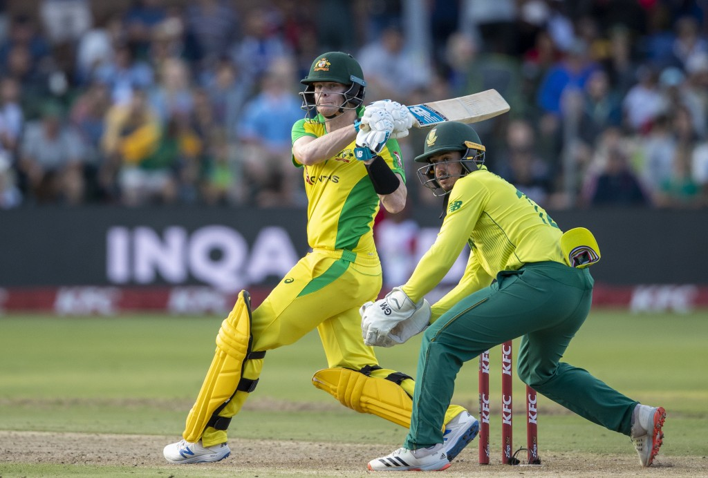 Australia's batsman Steven Smith, watches his shot as South Africa's captain Quinton de Kock looks on during the 2nd T20 cricket match between South A...