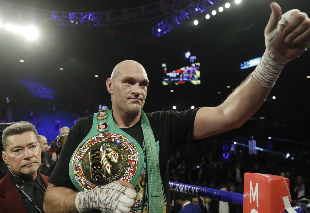 Tyson Fury, of England, celebrates after defeating Deontay Wilder during a WBC heavyweight championship boxing match Saturday, Feb. 22, 2020, in Las V...