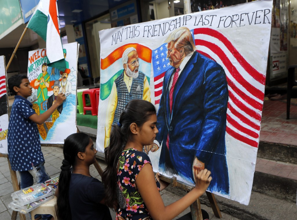 FILE - In this Feb. 21, 2020, file photo, children from an art school make paintings of U.S. President Donald Trump and India Prime Minister Narendra ...