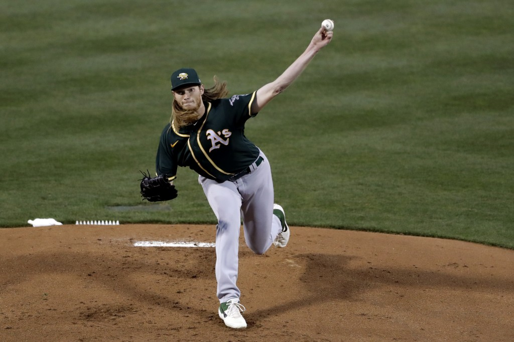 Oakland Athletics starting pitcher A.J. Puk pitches to a Chicago Cubs batter during the first inning of a spring training baseball game Saturday, Feb....