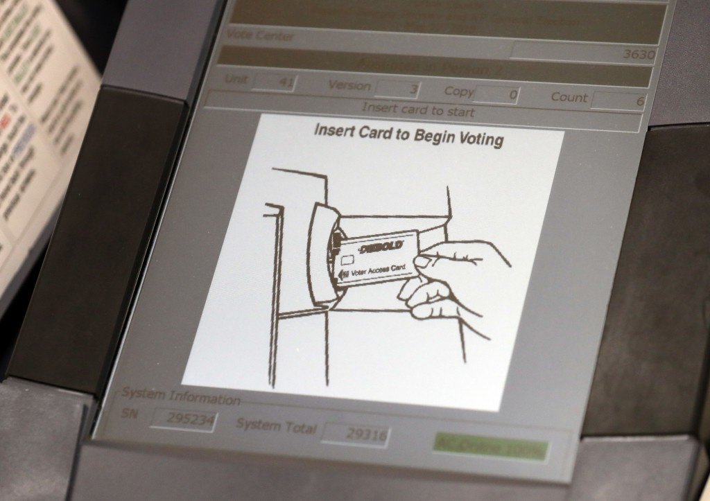 FILE - This May 9, 2018, file photo, shows a touch screen of a voting machine during early voting in Sandy Springs, Ga. In the rush to find reliable n...