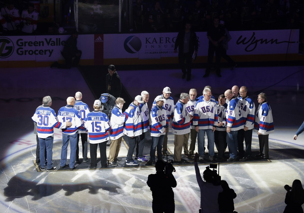 """Members of the gold medal 1980 """"Miracle on Ice"""" U.S. Olympic hockey team are honored prior to an NHL hockey game between the Golden Knights and the Fl..."""