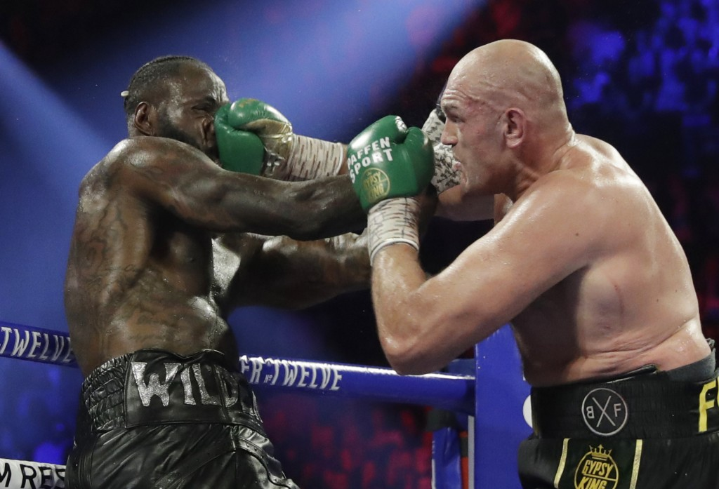 Tyson Fury, of England, lands a right to Deontay Wilder during a WBC heavyweight championship boxing match Saturday, Feb. 22, 2020, in Las Vegas. (AP ...