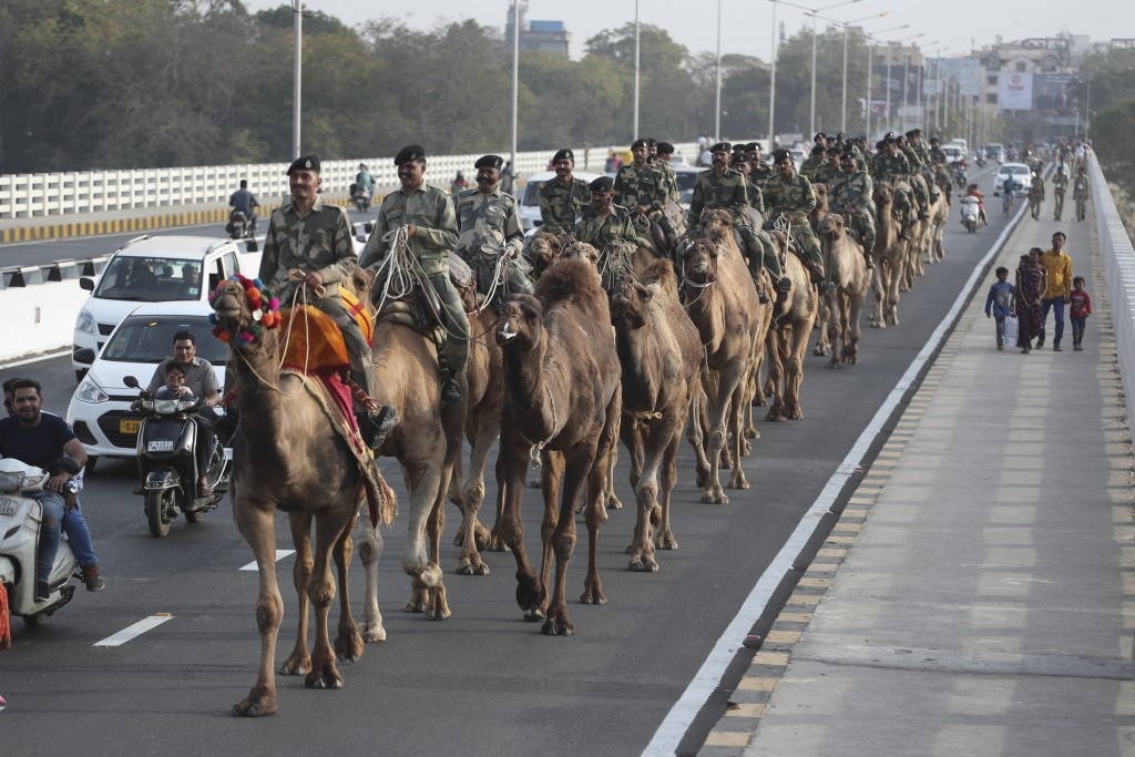 FILE - In this Feb. 21, 2020, file photo, Border Security Force (BSF) soldiers march on the route that U.S. President Donald Trump will travel in Ahma...