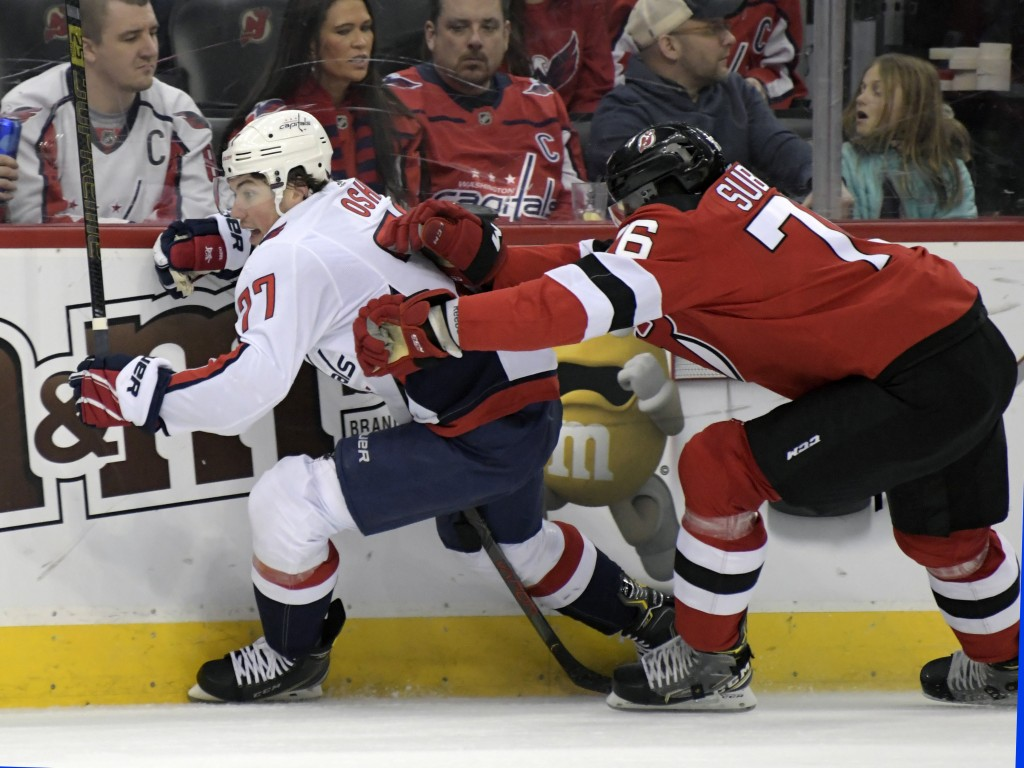 New Jersey Devils defenseman P.K. Subban (76) checks Washington Capitals right wing T.J. Oshie (77) during the first period of an NHL hockey game Satu...