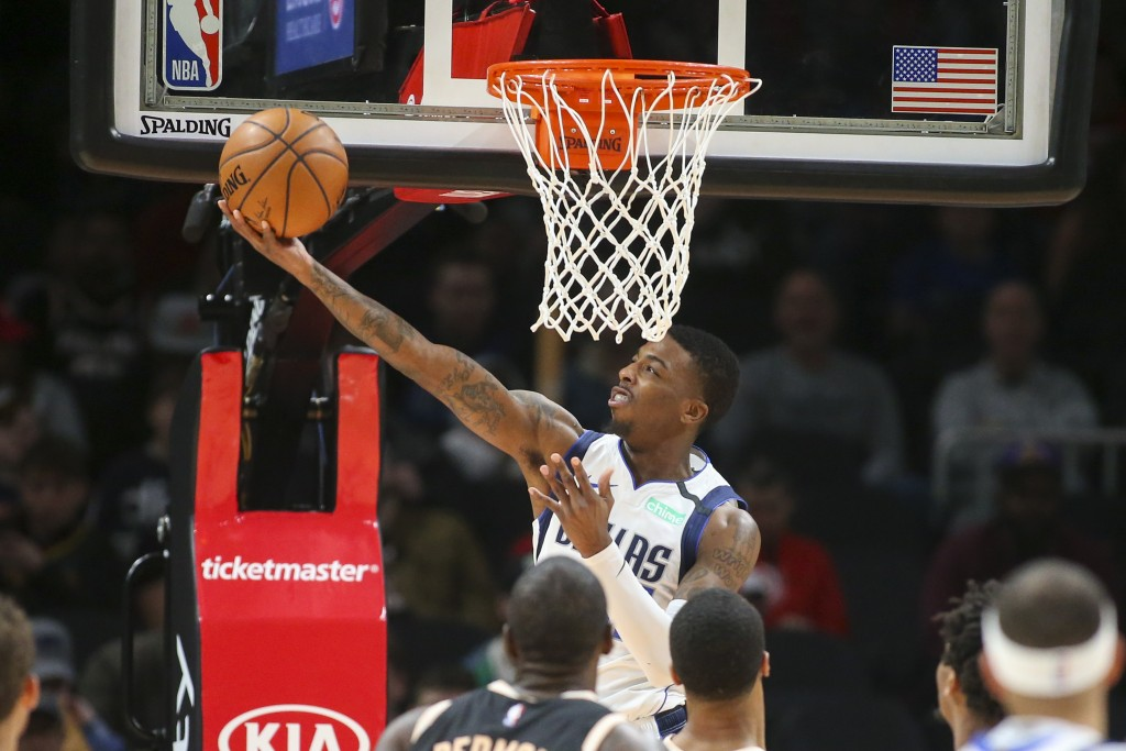 Dallas Mavericks guard Delon Wright (55) makes a basket in the first half of an NBA basketball game against the Atlanta Hawks, Saturday, Feb. 22, 2020...