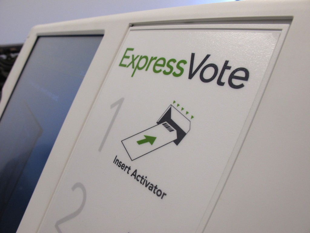 FILE - In this Aug. 16, 2019, file photo, a digital voting machine sits on a table in Raleigh, N.C. North Carolina. In the rush to find reliable new v...