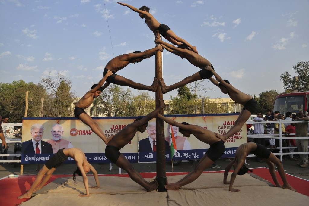 Indian children perform Mallakhamb, a traditional training exercise for wrestlers along a route U.S. President Donald Trump is expected to take during...