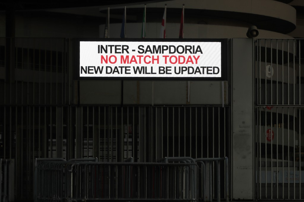 A notice outside San Siro stadium advises that the Serie A match between Inter and Sampdoria is cancelled, in Milan, Italy, Sunday, Feb. 23, 2020. In ...