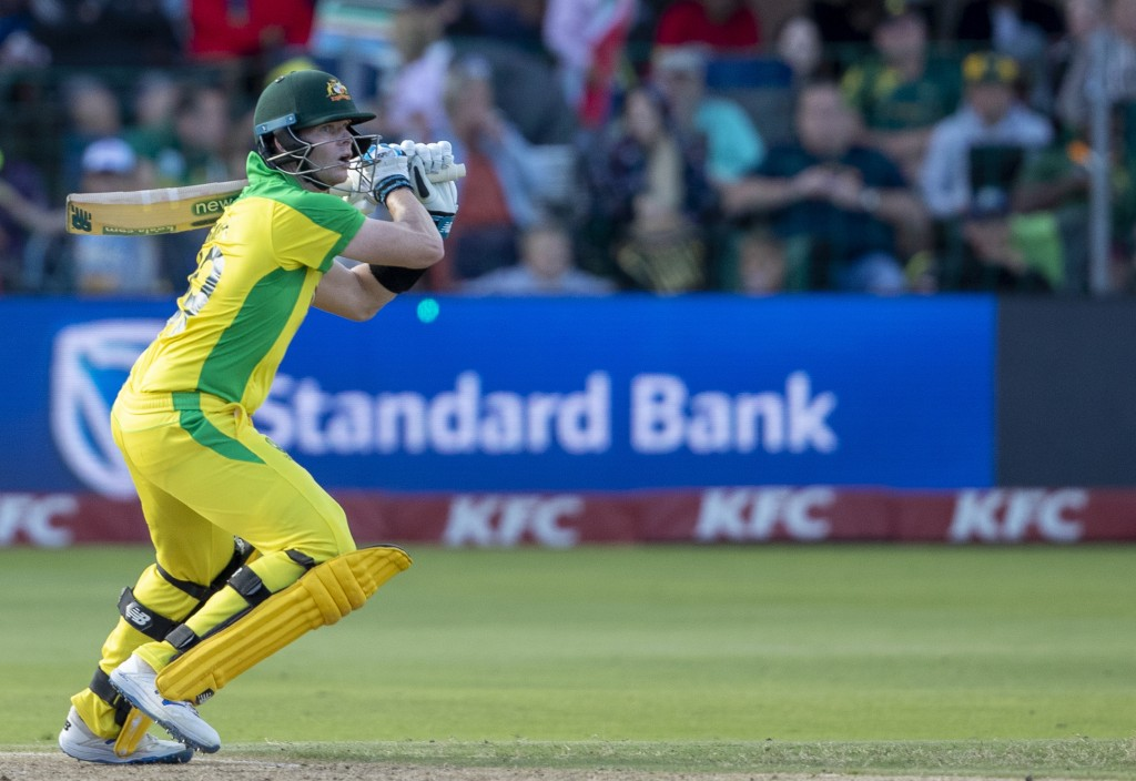 Australia's batsman Steven Smith watches his midair shot during the 2nd T20 cricket match between South Africa and Australia at St George's Park in Po...