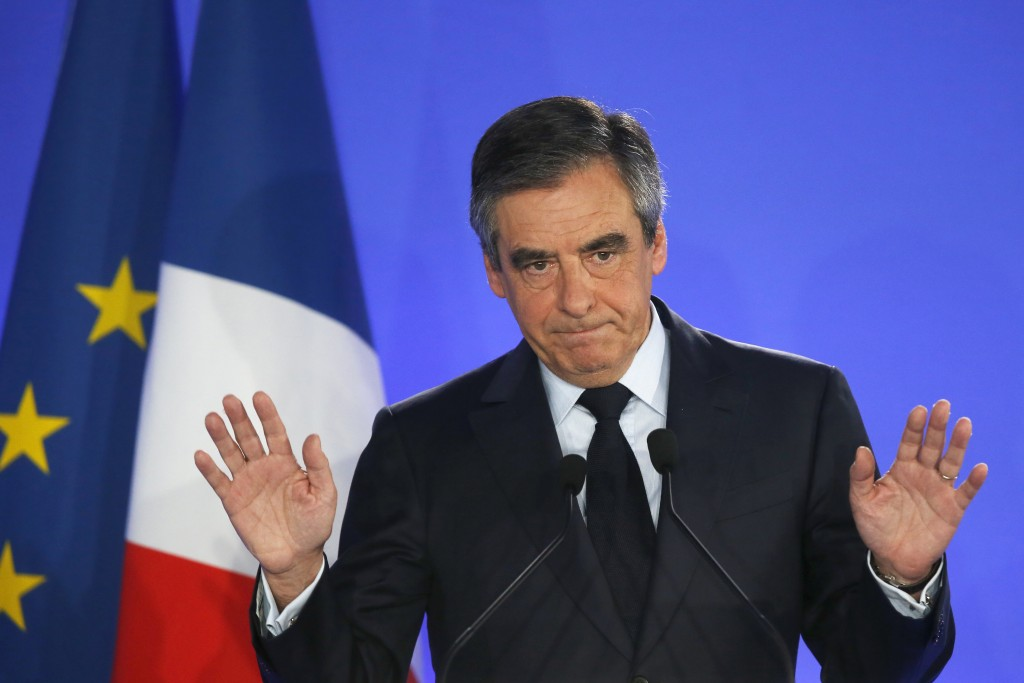 FILE - In this Sunday, April 23, 2017 file photo, French conservative presidential candidate Francois Fillon addresses his supporters after the first ...