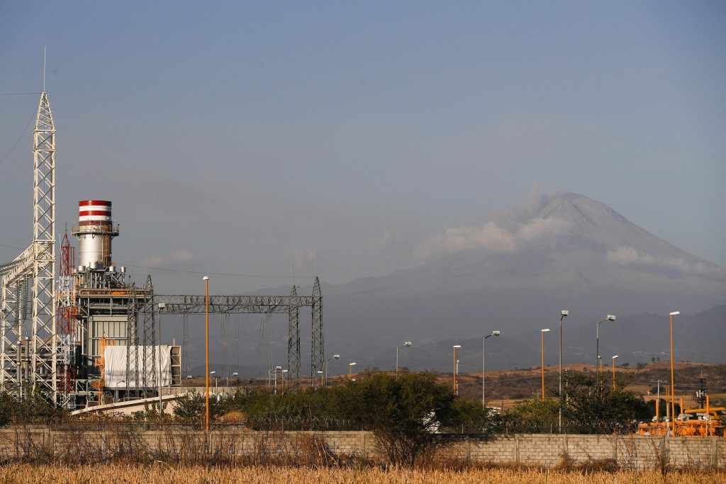 A newly built power generation plant stand idle with the Popocatepetl Volcano in the background, near Huexca, Morelos state, Mexico, Saturday, Feb. 22...