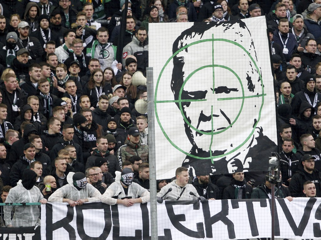 Supporters of Moenchengladbach show a banner with the portrait of Dietmar Hopp during the German Bundesliga soccer match between Borussia Moenchenglad...
