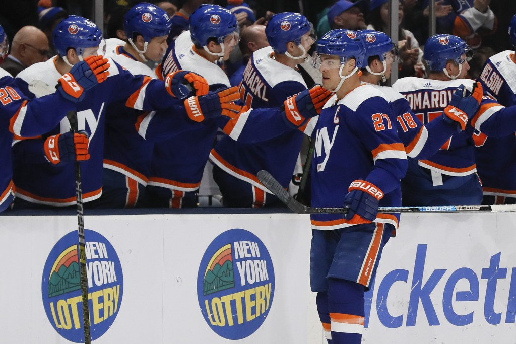 New York Islanders left wing Anders Lee (27) celebrates after his goal during the first period of an NHL hockey game against the San Jose Sharks, Sund...