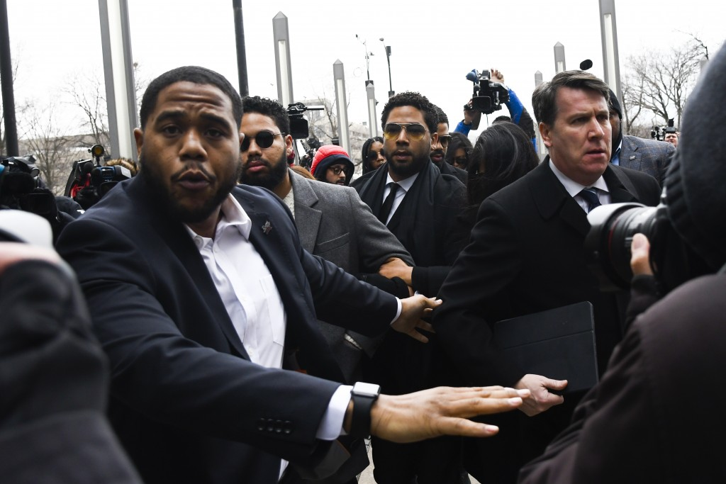 "Former ""Empire"" actor Jussie Smollett, center, arrives for an initial court appearance Monday, Feb. 24, 2020, at the Leighton Criminal Courthouse in C..."