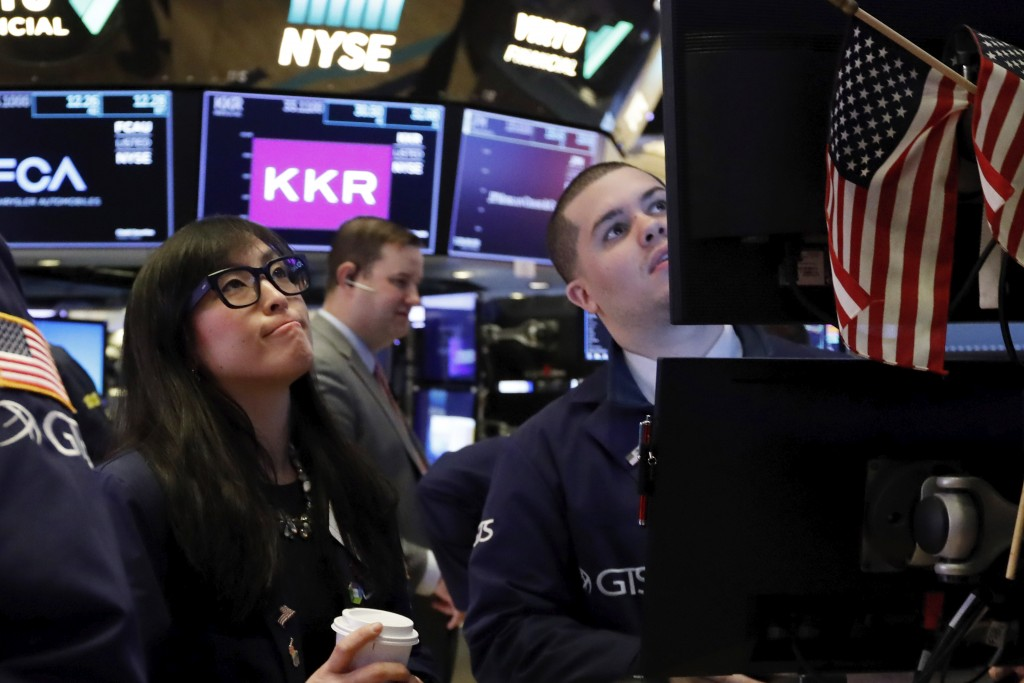 Specialist Erica Fredrickson works with a colleague on the floor of the New York Stock Exchange, Monday, Feb. 24, 2020. Stocks are opening sharply low...
