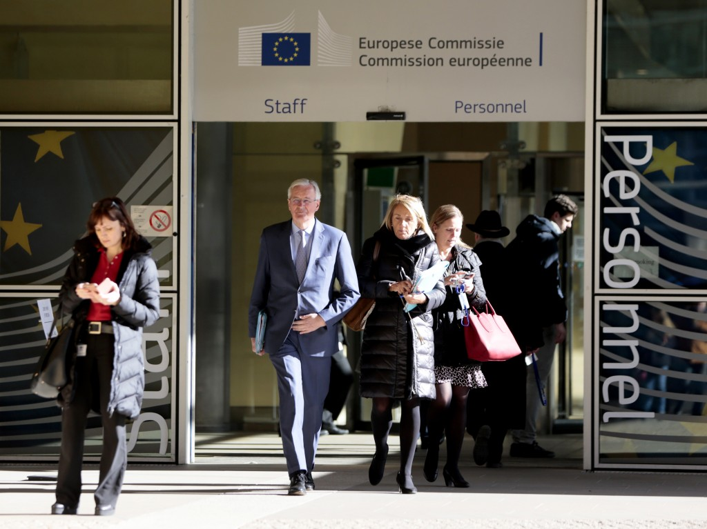 European Union chief Brexit negotiator Michel Barnier, center, walks to an EU General Affairs ministers from EU headquarters in Brussels, Tuesday, Feb...